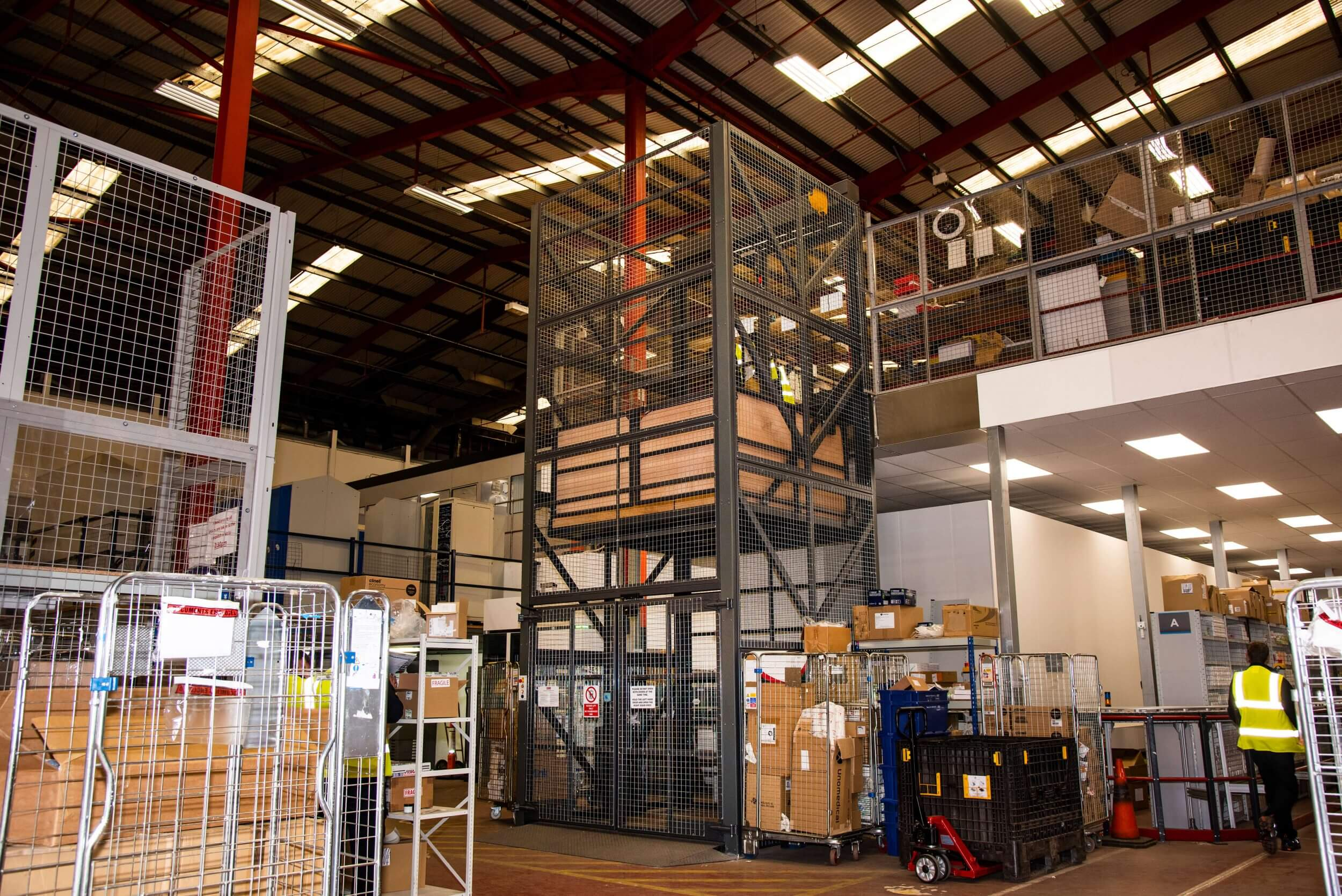 Mezzanine goods lift in use