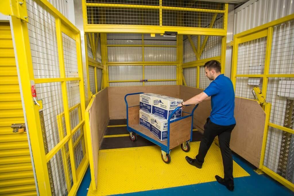 Man loading a goods lifts