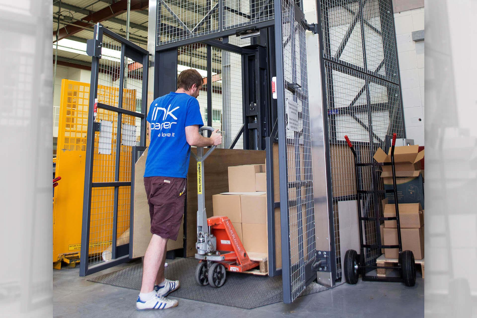 Man loading goods lift